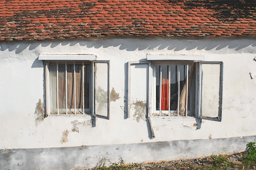 Old white home with original windows.